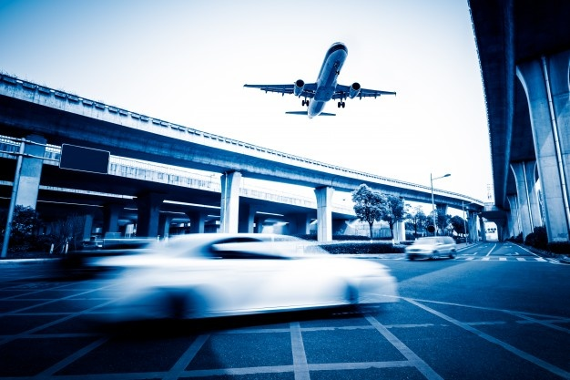 blurred-street-scene-city-with-plane-flying_1359-236